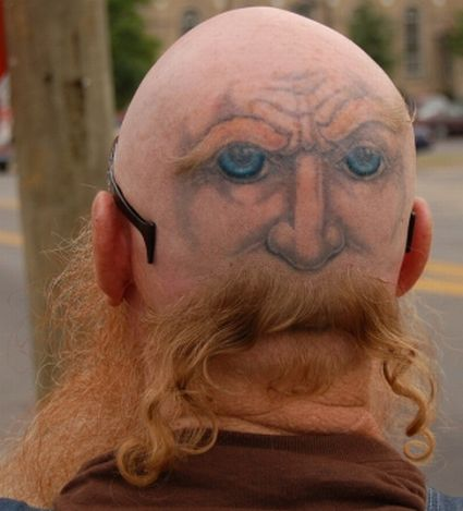 face on head tattoo